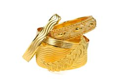 Gold bracelets stock photography