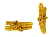 Gold bracelets & bangles. 22 karat gold bracelet standing on isolated background stock photography