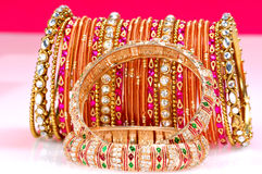 Gold bracelets and bangles. Golden bracelets and bangles weared by indian bride on her marriage Stock Photo