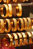 Gold bracelets and bangles Royalty Free Stock Photography
