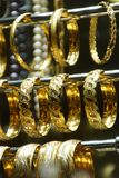 Gold bracelets and bangles Royalty Free Stock Image