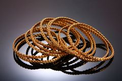 Gold bracelets isolated on black Royalty Free Stock Photography