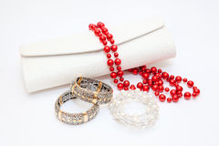 Gold bracelets red and wite necklace Royalty Free Stock Photography