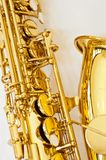 Close up of alto saxophone lower key holes royalty free stock images