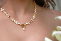 Gold bridal necklace with diamonds and perl stock photos