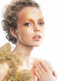 Gold bright make-up. Beauty woman face. Creativity Stock Photography