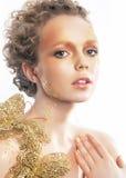Gold bright make-up. Beauty woman face. Creativity Stock Photography