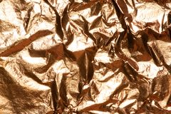 Gold bright shiny texture of a crumpled sheet. Gold bright shiny texture of a crumpled sheet foil stock images