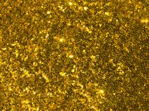 Gold brilliant glitter confetti background. stock photos
