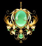 Gold brooch with chrysoprase gems Stock Photos