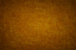 Gold brown autumn colored background paper vintage texture Royalty Free Stock Image
