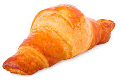 Gold-brown baked croissant in front of a white background Royalty Free Stock Images