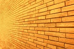 Gold and brown brick wall texture in oblique patterns abstract for background stock photography