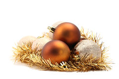 Gold and brown Christmas ornaments Stock Images