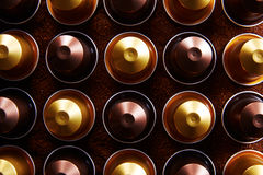 Gold and brown coffee capsules Royalty Free Stock Photo