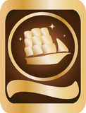 Gold, brown emblem. Depicting a sailing ship Stock Photos