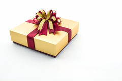 Gold and brown gift box with ribbon bow. Royalty Free Stock Images
