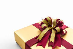 Gold and brown gift box with ribbon bow. Stock Image