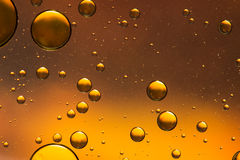 Gold and brown oil and water abstract. Giving the impression of rising bubbles Royalty Free Stock Image