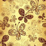 Gold-brown seamless pattern. Gold and brown seamless pattern with lacy butterflies (vector Royalty Free Stock Images