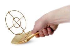 Gold brush in hand Stock Photo