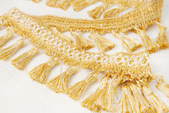 Gold brush made of thread Royalty Free Stock Photo