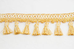 Gold brush made of thread Royalty Free Stock Images