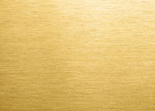 Gold brushed metal background. Gold brushed metal texture or background. Close up Stock Photos
