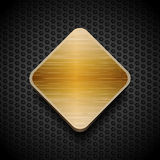 Gold brushed panel on black mesh background Royalty Free Stock Images