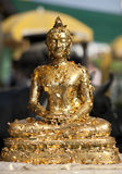 Gold Buddha. Buddha figure decorated by worshippers with real gold leaf. Bangkok Thailand Royalty Free Stock Photos