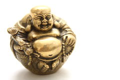 Gold Buddha. Portrait of a gold laughing buddha statuette Stock Image