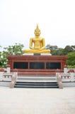 Gold Buddha with base on white background Stock Image