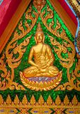 Gold buddha decorative on the wall Stock Image