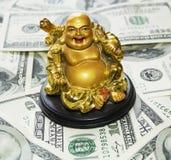 Gold  Buddha on dollars Royalty Free Stock Photos