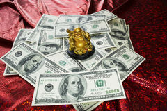 Gold  Buddha on dollars Royalty Free Stock Images
