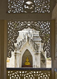 Gold Buddha framed in architecture Stock Photos