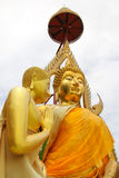 Gold Buddha and gold attendant Royalty Free Stock Photos
