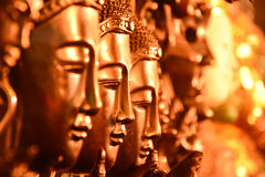 Gold Buddha head arranged selective focus. Stock Photography