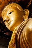 Gold Buddha Head from below. In a temple in myanmar Stock Photography