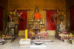 Gold buddha image statue in church at Wat Chalong Stock Image
