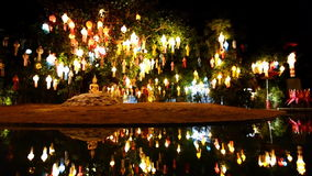 Gold buddha image under lantern tree stock video