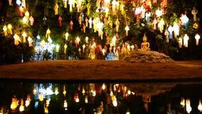 Gold buddha image under lantern tree stock video footage