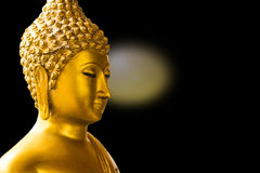 Gold Buddha isolated  black background Royalty Free Stock Photography
