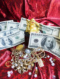 Gold Buddha, jewelry and money Stock Photos
