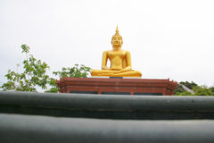 Gold Buddha nearby base view on white background Royalty Free Stock Photo