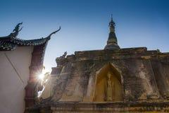 Gold buddha on pagoda with sunlight Royalty Free Stock Photo
