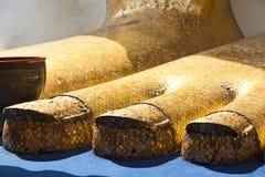 Gold Buddha's Feet. The giant golden feet of a standing Buddha at Wat Intharawihan in Bangkok, Thailand Stock Image