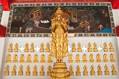 Gold Buddha stand on wall Stock Photos