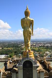 Gold buddha standing on a mountain Wat Phr That Khao Noi,Nan Province, Thailand Royalty Free Stock Photo