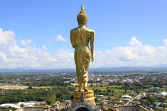 Gold buddha standing on a mountain Wat Phr That Khao Noi,Nan Province, Thailand Royalty Free Stock Photography